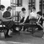 Students playing cards in Madonna lobby, 1959.
