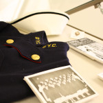 Nursing cap, cape and photograph